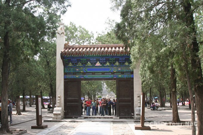 The Erzhumen gate in the courtyard beyond the five stone sacrificial vessels.